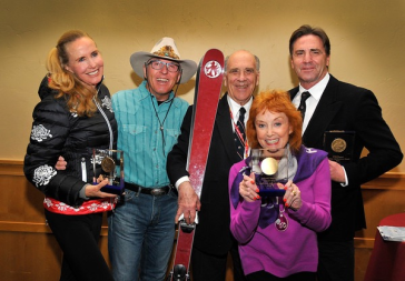 FRY HONORED. In photo, left to right: Ski ballet star Suzy Chaffee, 1964 Olympic slalom medalist Billy Kidd, John Fry, fashion editor Barbara Alley Simon, and freestyle and extreme skiing movie star John Eaves gathered at Skiing History Week in Steamboat Springs, Colorado, April 2015. On his retirement as its Chairman, the International Skiing History Association presented Fry with a pair of custom-made Wagner skis emlazoned at their tips with the logo of the Red Birds Ski Club, North America's oldest alpine-dedicated ski club. Fry has been a member of the club since 1950.
